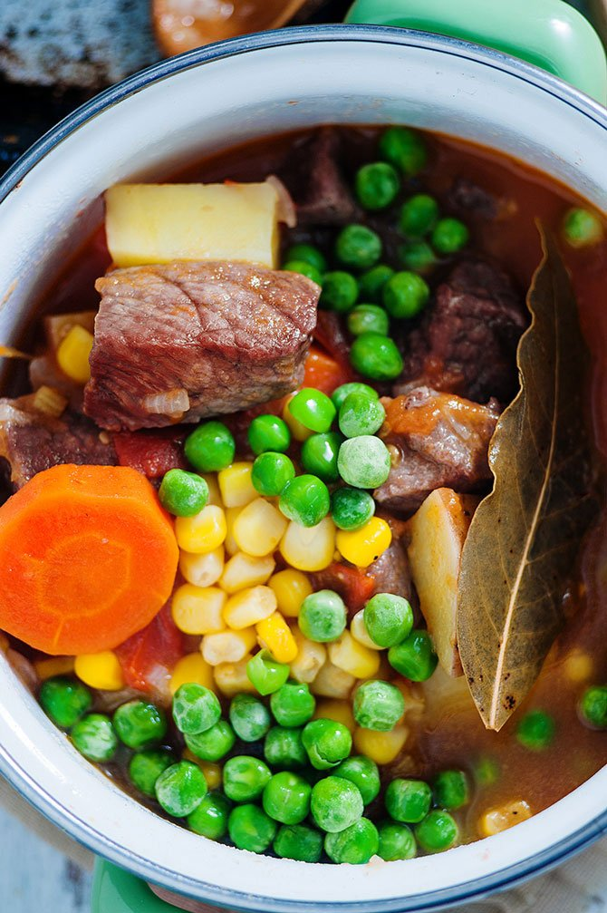 vegetable beef soup ingredients close up peas and carrots