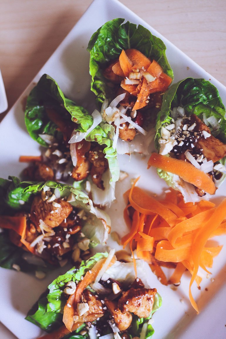 chicken lettuce wraps on plate with carrot slices