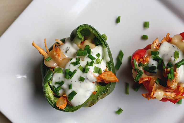 stuffed peppers on plate topped with ranch and chicken