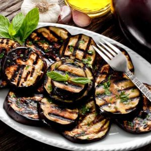 grilled eggplant on plate with olive oil dressing