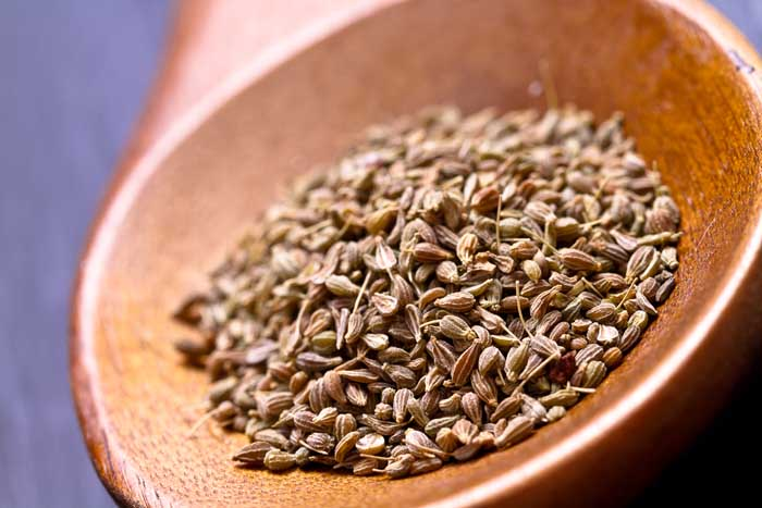Anise seeds on wooden spoon