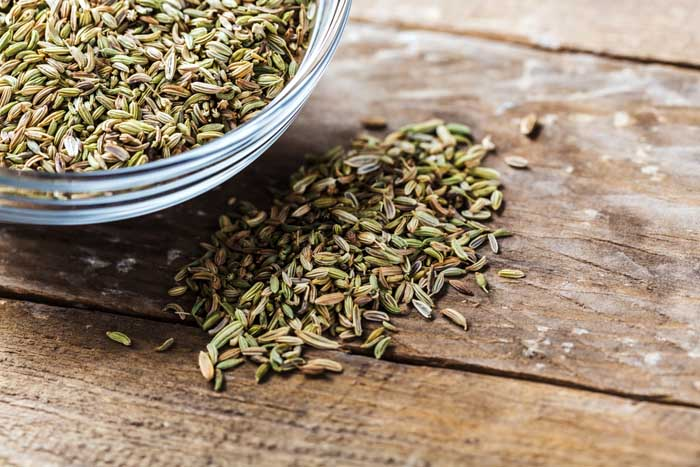 Closeup of fennel seeds in a glass bowl
