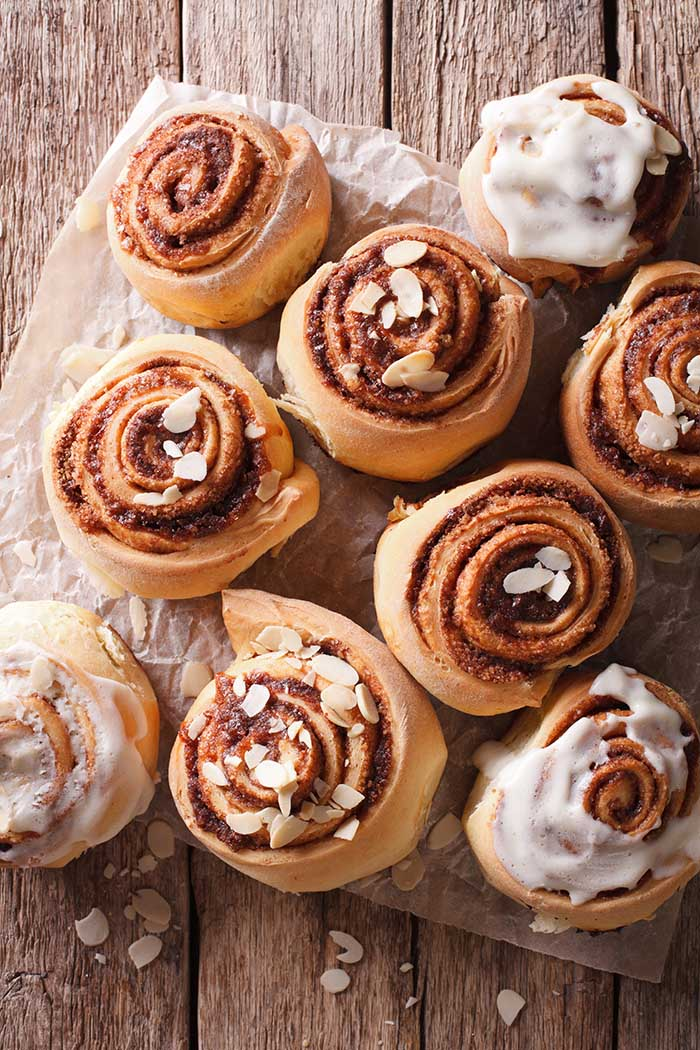 Cinnamon rolls with almond close up on the table