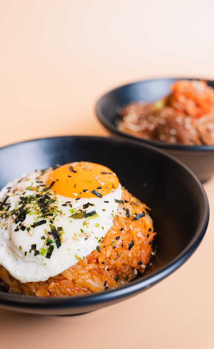 Kimchi fried rice with pork and fried egg and gochujang pork