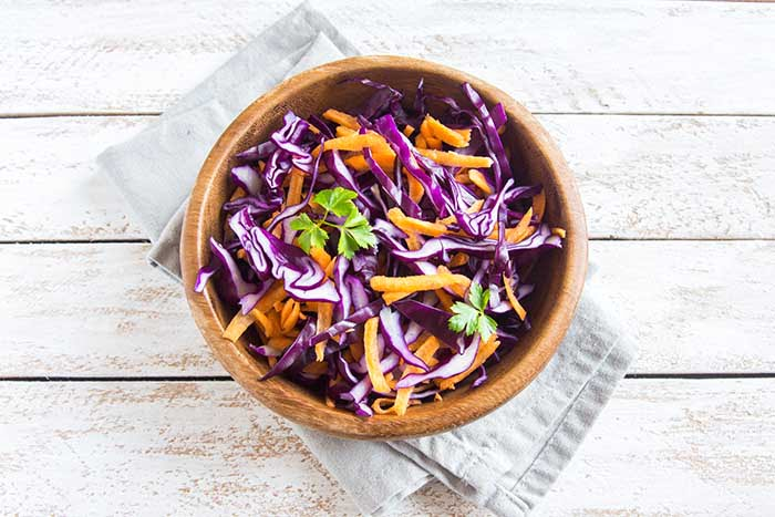 Red Cabbage Coleslaw Salad with Carrots and Greens