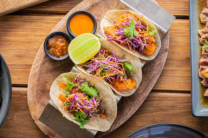 Shrimp tacos with purple and white cabbages with cheese