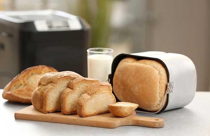Tasty sliced loaf on table