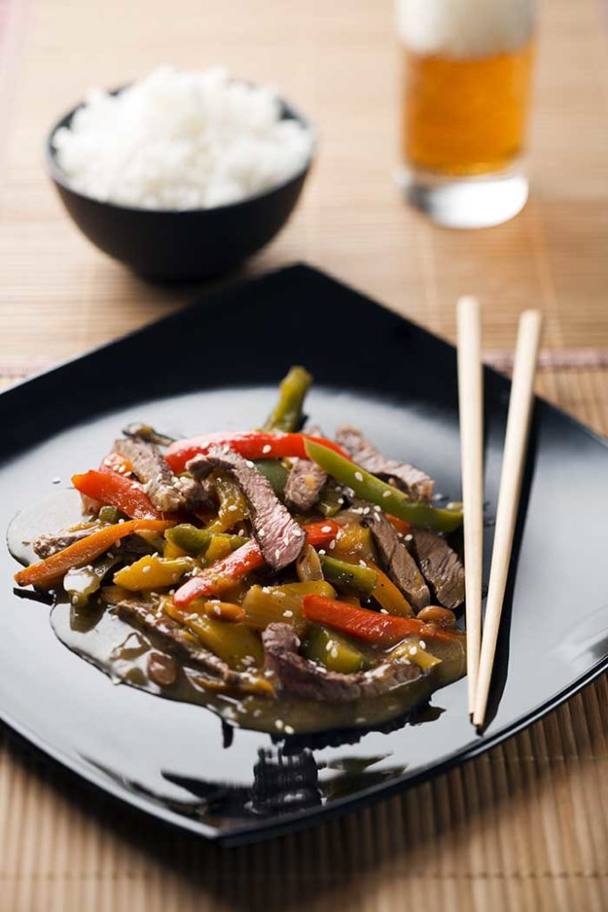 beef chop suey on plate served with white rice and beef