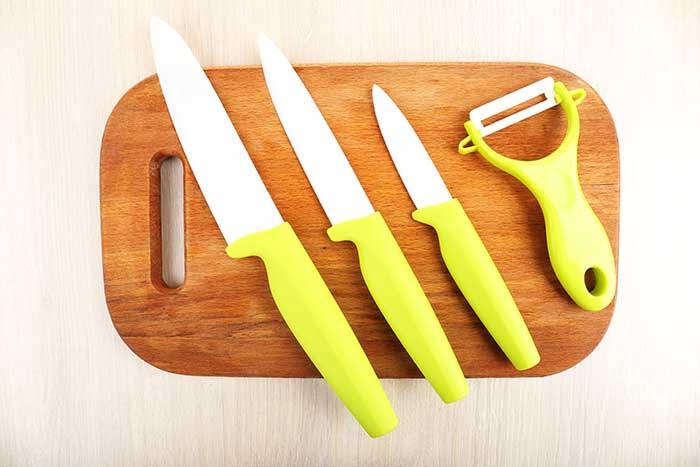 ceramic kitchen knives on cutting board