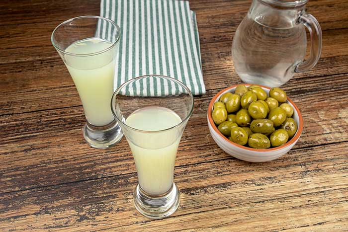 glass of Pastis on a wooden table