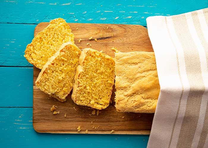 homemade yellow sliced cornbread loaf