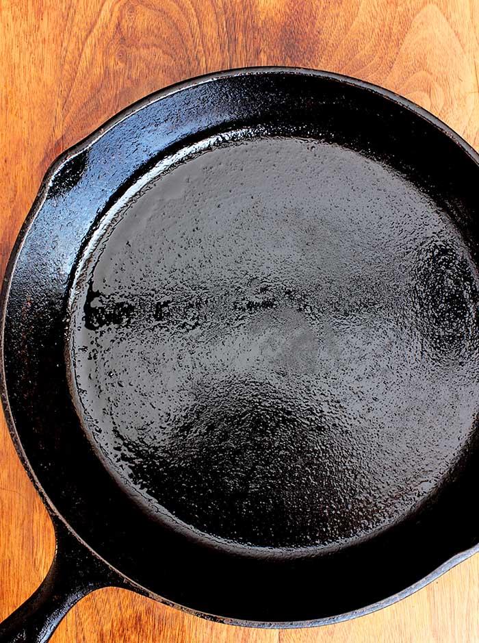 freshly seasoned cast iron pan