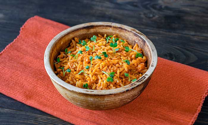 Bowl of Mexican rice on wooden table
