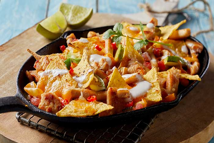 nachos assembled on skillet for reheating