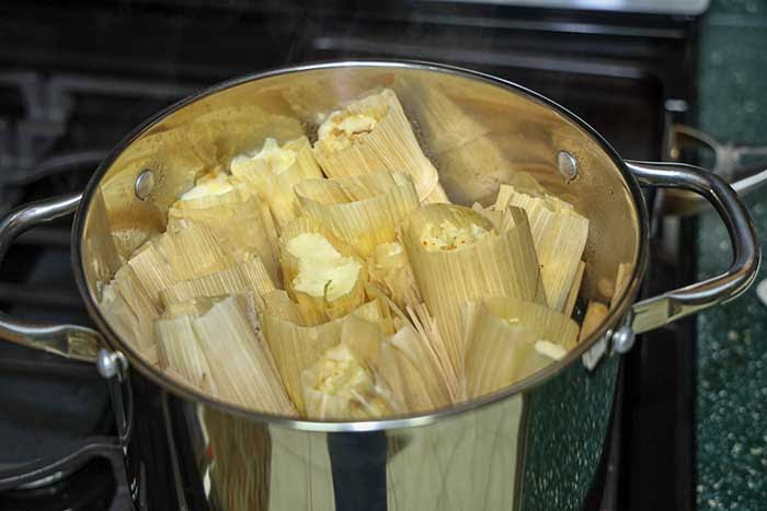 View of cooked tamales inside pot.